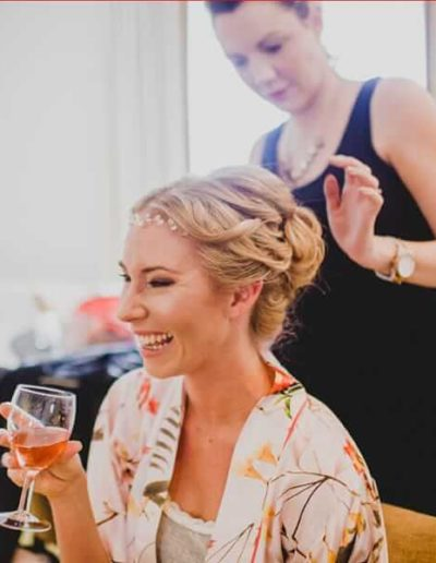 bride having hair finished on wedding day by pretty please by katie
