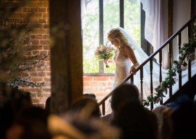 hair and make up by pretty please for a cooling castle bride walking down the stairs