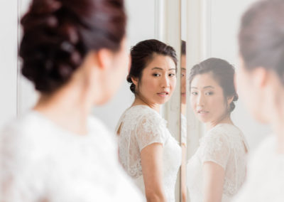 bride glancing over her shoulder at wedding hair and make up