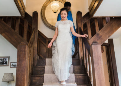 bride walking dwown stairs at hayne house